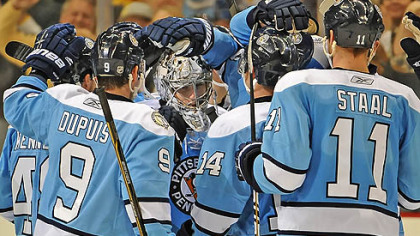 Marc-Andre Fleury is mobbed by teammates Sunday after the Penguins beat the Florida Panthers at Consol Energy Center.