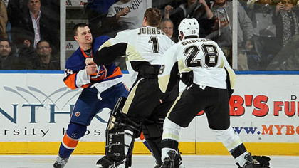 Islanders forward Micheal Haley fights Penguins goaltender Brent Johnson in the third period of Friday&#039;s game at Nassau Coliseum in Uniondale, New York as Penguins forward Eric Godard joins in.