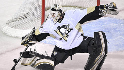 Penguins goaltender Brent Johnson deflects a shot during the first period of Thursday's game against the Canadiens at the Bell Centre in Montreal.