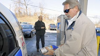 Eaton's Dale Jones hooks up a Mitsubishi all-electric car to the company's Type 3 commercial charging station.