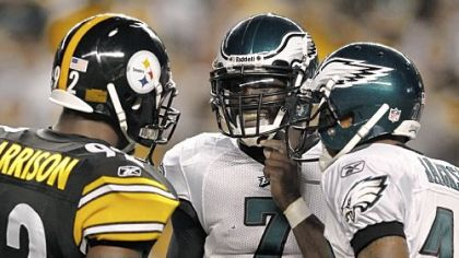 Linebacker James Harrison talks with Eagles quarterback Michael Vick and receiver DeSean Jackson between plays in the second quarter Thursday night.