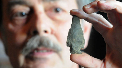 Mike Kotz of Claysville shows a Native American artifact dating back 9,000 years.
