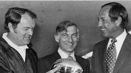 Steelers coach Chuck Noll and team owner Dan Rooney accept the Lombardi Trophy from NFL commissioner Pete Rozelle following Super Bowl XIII.