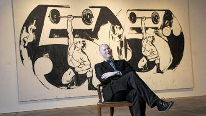 "Eric C. Shiner, recently appointed director of The Andy Warhol Museum, photographed at the museum in May in front of Andy Warhol's ""Double $5/Weightlifter"" of 1985-86."