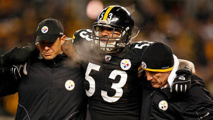 Steelers center Maurkice Pouncey is helped off of the field after being injured in the first quarter of the AFC championship game at Heinz Field Sunday.