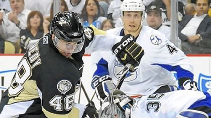 Tyler Kennedy is stopped by Tampa Bays goaltender Dwayne Roloson in Game 7 Wednesday at Consol Energy Center. The inability to consistently get pucks past Roloson, especially on the power play, ultimately knocked the Penguins out of the Stanley Cup playoffs in the first round.