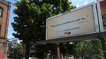A billboard for the Hear Me project, which seeks to give voice to area children's thoughts, dreams and fears, along Second Avenue in Hazelwood.