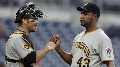Catcher Ryan Doumit fist-bumps reliever Jose Veras after Veras survived a rocky ninth inning Wednesday at Petco Park.