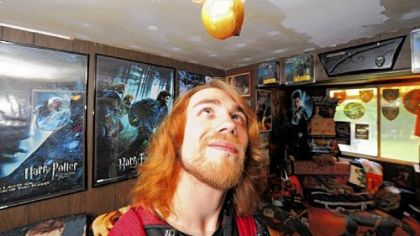 "Steve Petrick, 22, of Brighton Heights, ""lives"" Harry Potter. He has a ""snitch"" hanging from his ceiling."