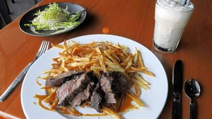 Steak frites with pork fat fries, an asparagus and sprouts salad with foie gras-hollandaise sauce and an ice cream soda at Bite Bistro in Bellevue.