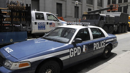 A Gotham City police car and a military vehicle are ready for action along Smithfield Street, Downtown, on Aug. 10.