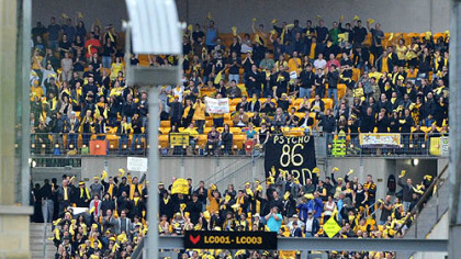 "Extras cast as fans of the Gotham Rogues cheer at Heinz Field during filming of ""The Dark Knight Rises."""
