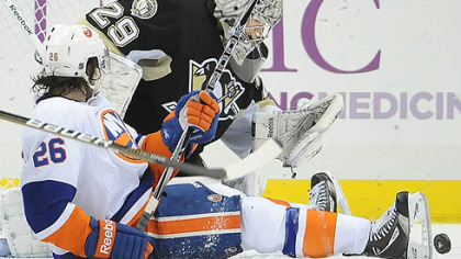 Penguins goaltender Marc-Andre Fleury makes a save on Islanders forward Matt Moulson in the third period of Tuesday's game at at the Consol Energy Center.