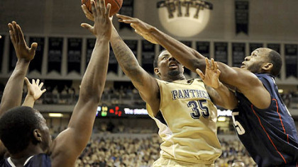 Pitt's Nasir Robinson drives to the net against Connecticut's Charles Okwandu during the team's only meeting earlier this season at the Petersen Events Center. Pitt won 78-63. The two teams will meet again tomorrow at noon in the Big East Tournament quarterfinals.