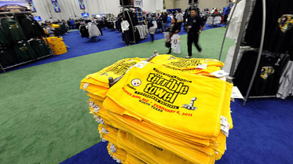 Terrible towels are stacked for sale at the NFL Experience at the convention center in Dallas.