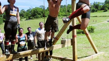 Stacey Keating, 25, right, makes it across the monkey bars at the Ruckus Pittsburgh event July 16.