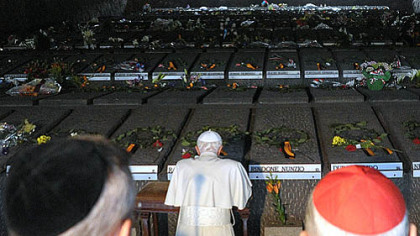 Pope Benedict XVI (kneeling) prays during his visit Sunday at Rome's Ardeatine Caves, where 335 Italians were slaughtered by occupying Nazis on March 24, 1944.