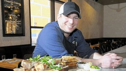 Richard DeShantz of Meat & Potatoes with his bone marrow with grilled breads.