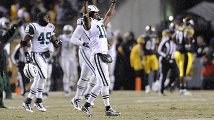 Jets' wide receiver Santonio Holmes celebrates at the end of a 22-17 win at Heinz Field Dec. 19.