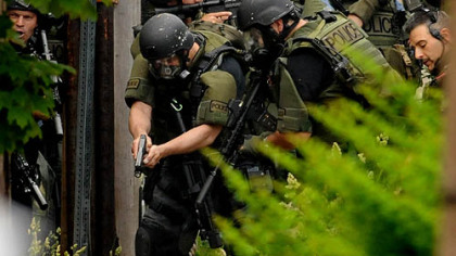 Pittsburgh's SWAT team converge on a man who was critically wounded by police during a standoff in Larimer.