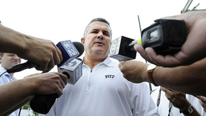 Pitt football coach Todd Graham, with staff members, speaks to season ticket holders Sunday at Petersen Event Center.
