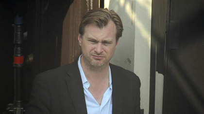 Early morning scenes and coffee for Christopher Nolan, director of the lastest Batman movie The Dark Knight Rises, who who waits to film on 41st Street in Lawrenceville.