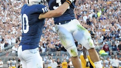 Penn State running back Joe Suhey, right, leaps into the arms of tight end Kevin Haplea after Haplea scored a touchdown, the only one of the game, against Iowa in the fourth quarter Saturday at Beaver Stadium.