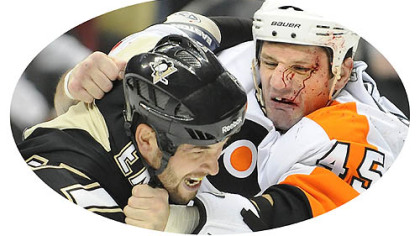In this file photo Penguins Deryk Engelland fights Flyers Jody Shelly.