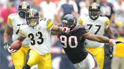 Steelers running back Isaac Redman picks up first down against the Texans.