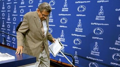 Coach Joe Paterno steps down from the stage after announcing at his weekly news conference that the Nittany Lions would stay with a two-quarterback system Saturday against Temple.