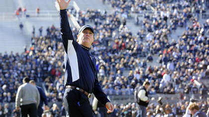 Penn State interim head football coach Tom Bradley waves to fans on the field before his team''s game against Nebraska today.