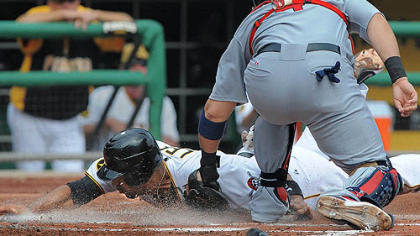 Pirates first baseman Derrek Lee is tagged out by Cardinals catcher Yadier Molina.