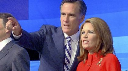 Former Massachusetts Gov. Mitt Romney points to the audience with Rep. Michele Bachmann, R-Minn, before a Republican presidential debate Thursday in Orlando, Fla.