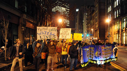 Protesters from Occupy Pittsburgh march from their camp at Mellon Green to the Developing Unconventional Gas East conference at the David L. Lawrence Convention Center on Tuesday.