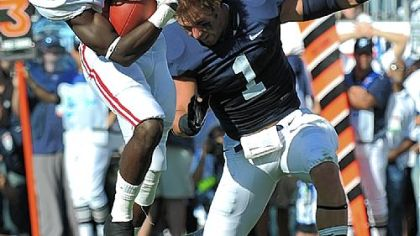 Penn State's Nick Sukay loses his helmet while putting a hit on Alabama's Kevin Norwood Saturday at Beaver Stadium.