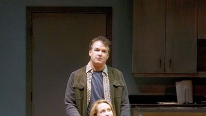 "Angela Reed and Andrew May portray a photojournalist and a reporter in City Theatre's production of ""Time Stands Still."""