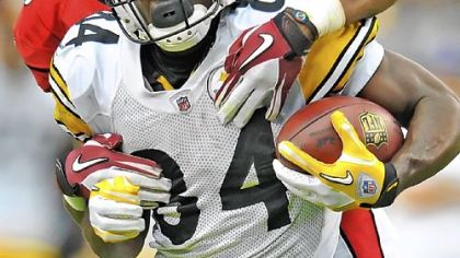 Antonio Brown picks up first down yardage against the Cardinals Sunday in Glendale, Ariz.