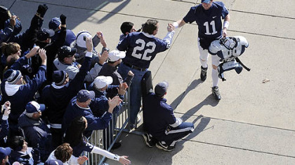 Penn State quarterback Matt McGloin greets fans as he enters Beaver Stadium before his team's game against Nebraska today.
