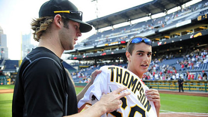 Pitcher Aaron Thompson signs away his jersey to Sam Sibeto of Tarentum, right, Sunday after the final game of the season at PNC Park. All players gave their jerseys away.