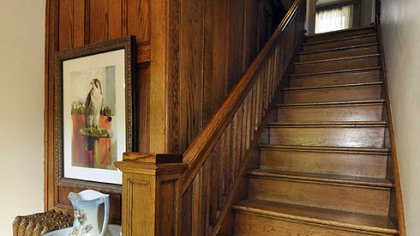 This staircase and paneling exemplify the Craftsman-style woodwork throughout the house.