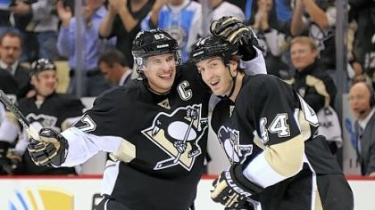 Penguins&#039; Sidney Crosby celebrates with Brooks Orpik after assisting on a  goal.