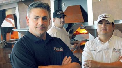 From left, general manager John Mowod and managers Jay Petroy and Carlos Trivelli of Anthony's Coal Fired Pizza in Robinson. The restaurant opens Saturday.
