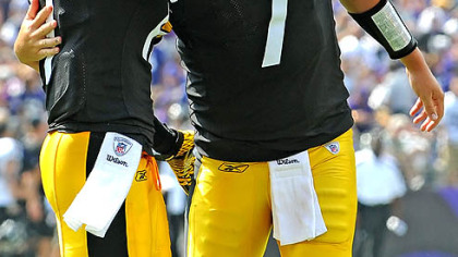 Ben Roethlisberger hugs Mike Wallace after throwing a touchdown pass against the Ravens Sunday in Baltimore.