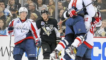 The Capitals celebrate a power-play goal by Dennis Wideman at 2:48 in overtime Thursday at Consol Energy Center