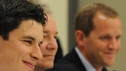 Sidney Crosby, left, talks to reporters accompanied by Penguins General Manager Ray Shero, center, and Director of the UPMC Sports Medicine Concussion Program Dr. Michael Collins.