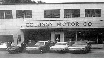 Standing outside the New Colussy Motors Dealership built in 1953.