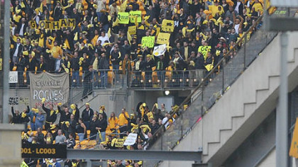 """Fans"" cheer at Heinz Field during a football game between Gotham and Rapid City."