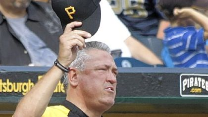 Manager Clint Hurdle doffs his cap to the crowd at PNC Park last Sunday during the final home game of the season -- his first as manager.