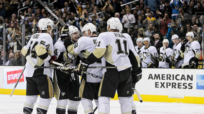 Teammates mob Chris Kunitz after his goal late in the third period tied the game.