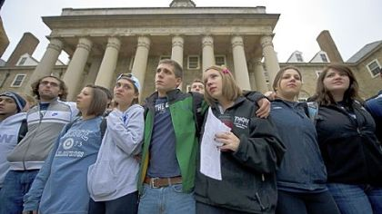 Penn State University students gather Thursday at Old Main, the school&#039;s administration building at the center of the campus, to express solidarity for the victims in the child abuse scandal involving former Penn State football coach Jerry Sandusky. Their vigil was a contrast to the rioting by students Wednesday night in reaction to head football coach Joe Paterno being fired as part of the university&#039;s reaction to the scandal.